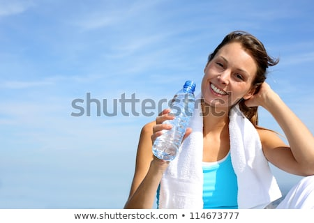 portrait of happy woman with towel holding water bottle stock photo © wavebreak_media