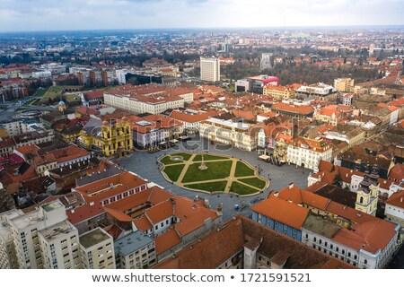 Romênia cadeiras praça céu edifício cidade Foto stock © dinozzaver