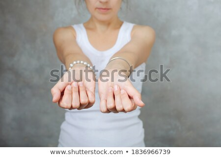 clenched a fist with plaster stock photo © leungchopan