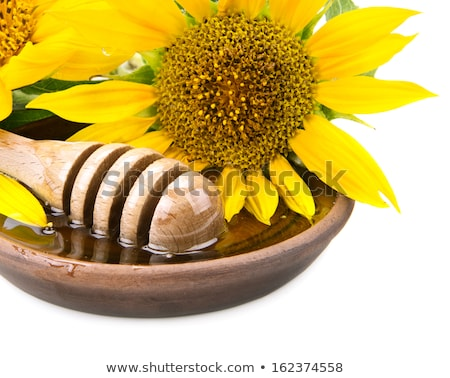 clay dish with honey drizzler and flowers sunflowers Stock photo © alinamd