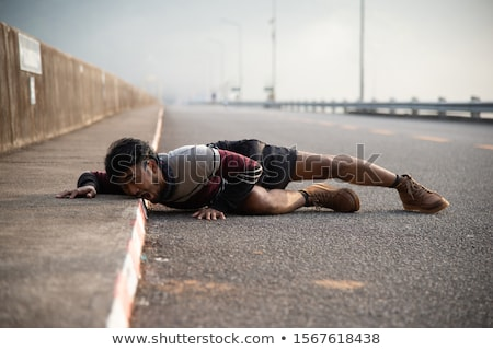 man lying down on a road Stock photo © nito