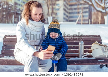 three young boys playing on a park bench in winter stock photo © d13