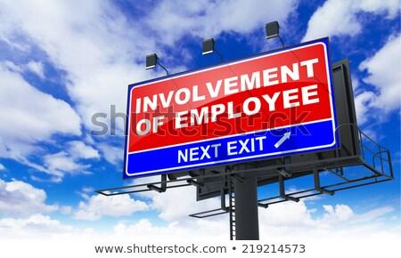 involvement of employee on red billboard stock photo © tashatuvango