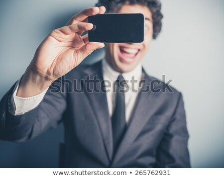 Manager taking himself a selfie with his mobile stock photo © Giulio_Fornasar