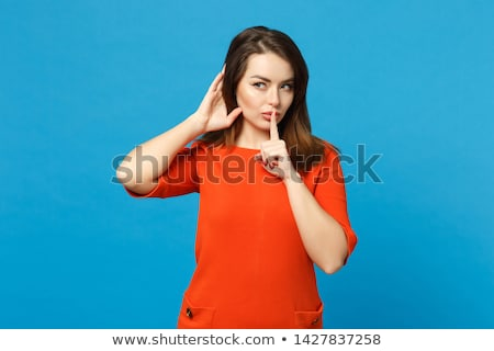 orange girl with finger on lips stock photo © stevanovicigor