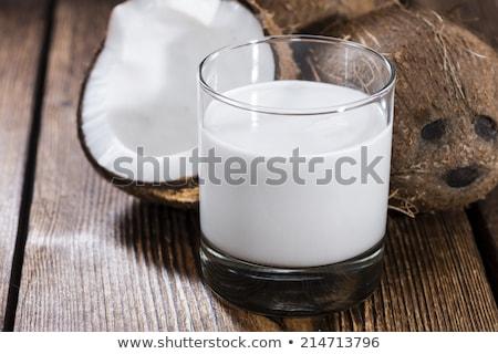 Leite de coco vidro escuro palma espaço Foto stock © joannawnuk