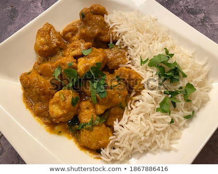 Chicken with rice and piquant sauce Stock photo © Makse
