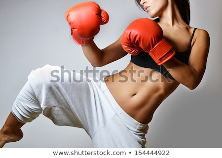 beautiful woman is boxing on gray background stock photo © master1305