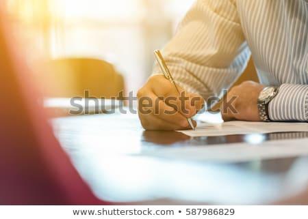 business man writing stock photo © fuzzbones0
