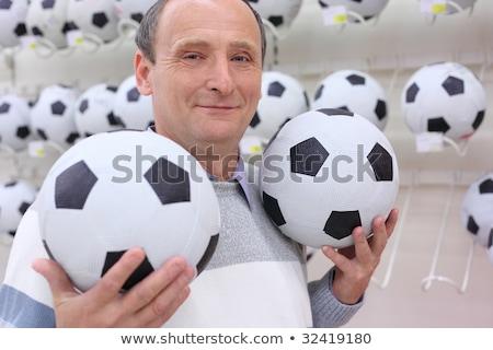 Starszych człowiek sklep ręce piłka nożna życia Zdjęcia stock © Paha_L