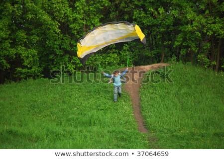 Jongen vliegen parachute glimlach onderwijs ruimte Stockfoto © Paha_L