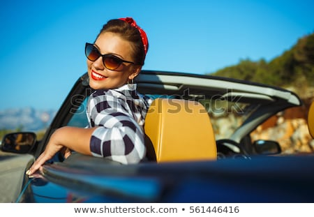 Beautiful pin up woman sitting in cabriolet, enjoying trip on lu Stock photo © vlad_star