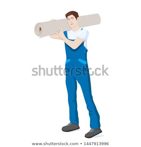 Сток-фото: Man Carrying A Carpet