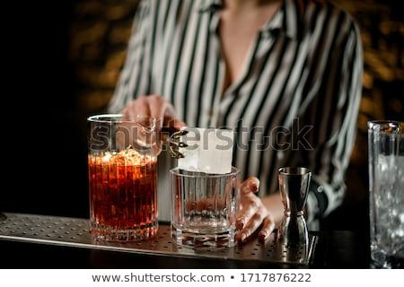 Vrouw dranken brandewijn mooie vrouw zwarte jurk sofa Stockfoto © ssuaphoto
