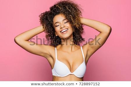 смеясь женщину бюстгальтер серый девушки стороны Сток-фото © deandrobot