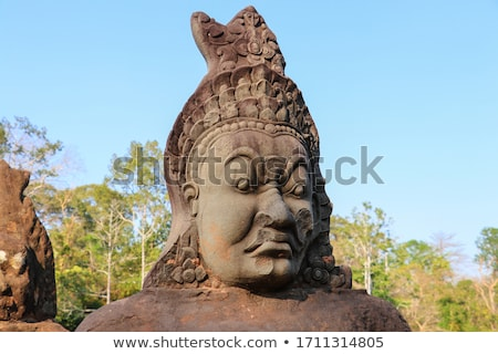 Stone carved statues of Devas in Cambodia Stock photo © Mikko