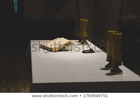 Open Bible and candles on the altar of a church Stock photo © franky242