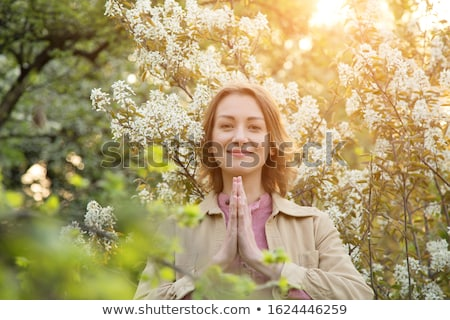 lovely young woman meditating in the garden stock photo © dash