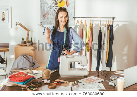 Smiling female tailor posing at camera Stock photo © dash