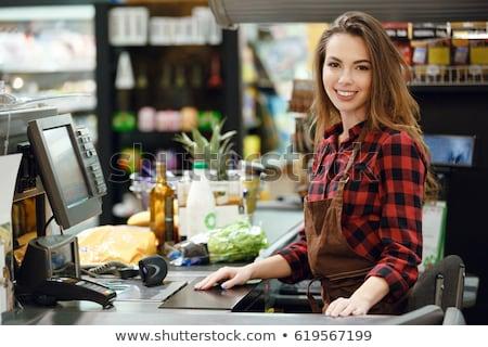 キャッシャー 女性 作業領域 スーパーマーケット 側面図 画像 ストックフォト © deandrobot