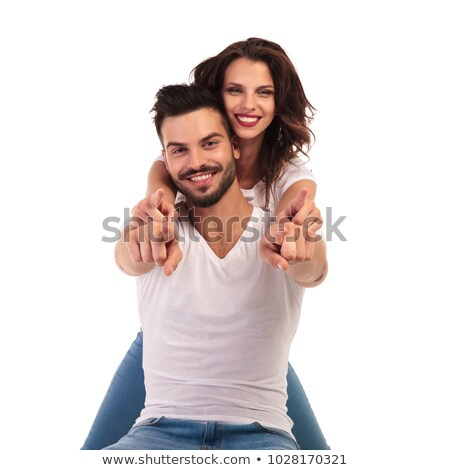 standing man and seated casual woman pointing fingers stock photo © feedough