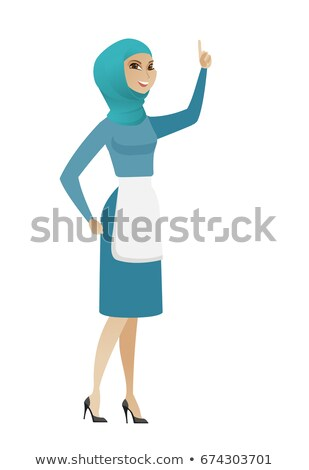 Young muslim cleaner pointing with her forefinger. Stock photo © RAStudio