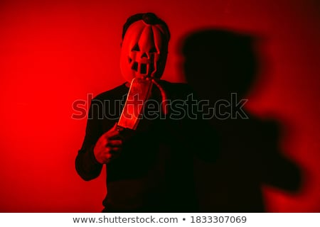 scary man with a pumpkin and a cleaver Stock photo © nito