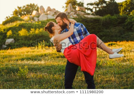Man carrying his woman,  in a field Stock photo © IS2