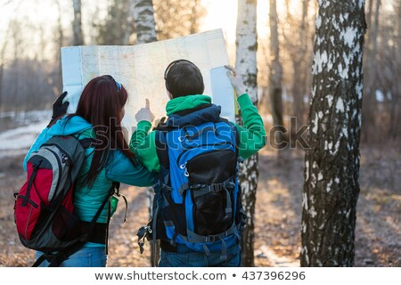man in mountains pointing with map Stock photo © IS2