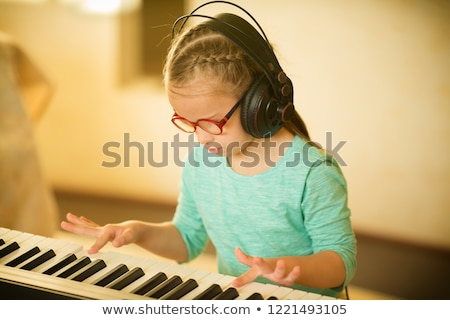 Kid Girl Piano Thinking Stock photo © lenm