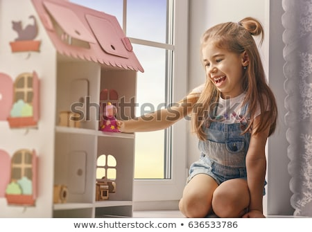 portrait of a smiling little girl playing games stock photo © deandrobot