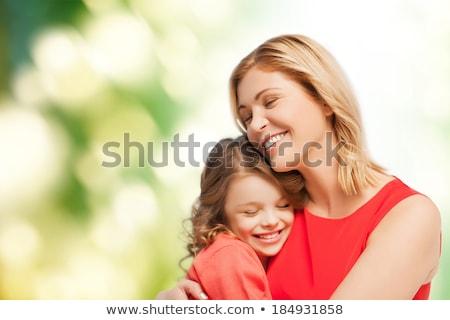 Anya lánygyermek üvegház nő virág jókedv Stock fotó © IS2
