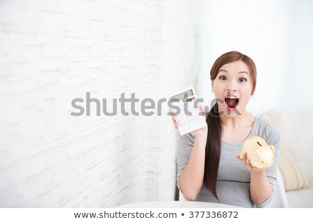 Asian woman sitting on bank safe stock photo © studioworkstock