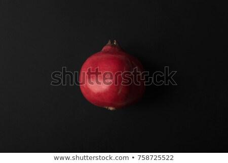 Ripe pomegranate isolated over black Stock photo © deandrobot