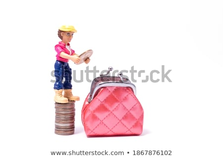 Girl placing coin on stack Stock photo © IS2
