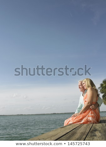 senior couple by river arm in arm stock photo © is2