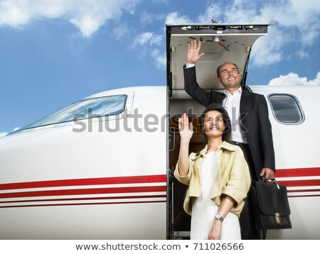 Couple exiting private jet Stock photo © IS2