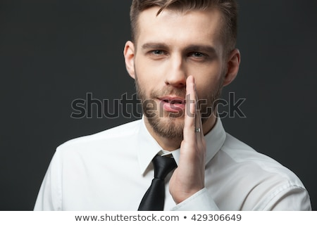The man whispers in secret isolated on white background Stock photo © studiostoks
