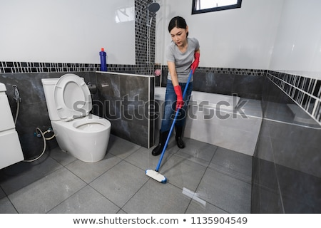 a maid cleaning dirty bathroom stock photo © bluering