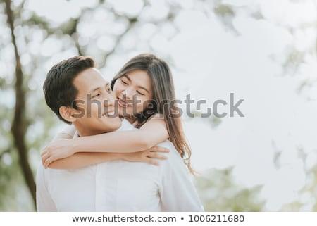 портрет молодые счастливым азиатских пару расслабляющая Сток-фото © Kzenon