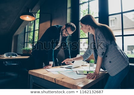 two young businesspeople analyzing graph in office stock photo © andreypopov