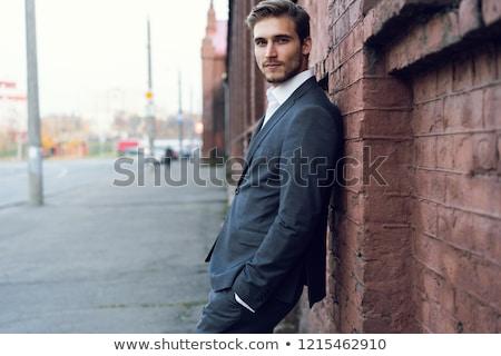 Vonzó fiatal férfi menedzser hivatalos tart Stock fotó © deandrobot