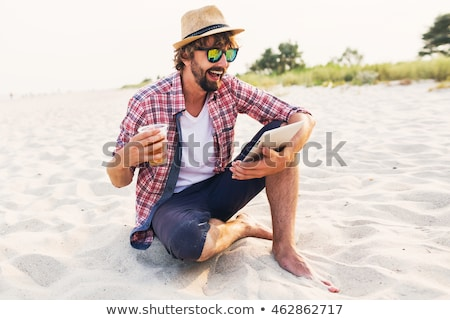 Portrait of a happy young man in straw hat stock photo © deandrobot