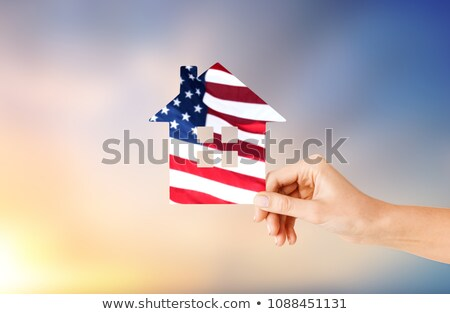 Stock photo: hand holding paper house in colors of american flag