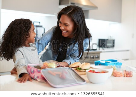 Mother And Daughter in front of a school Stock photo © Lopolo