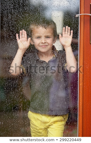 Sad little boy behind a window look sad Stock photo © Lopolo