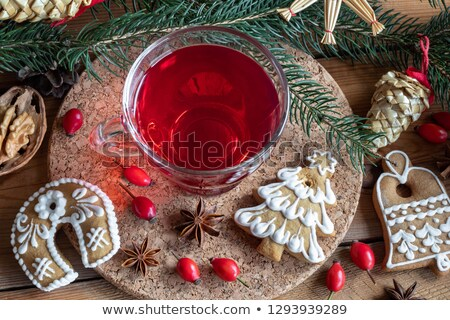 A cup of rose hip tea with Christmas gingerbread cookies Stock photo © madeleine_steinbach