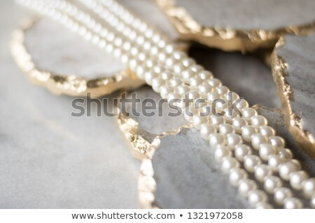 Pearl jewellery on marble, luxury background stock photo © Anneleven