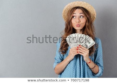 Izgatott nő pózol izolált szürke fal Stock fotó © deandrobot