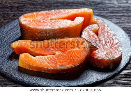 close up of lemon slice on slate table top Stock photo © dolgachov